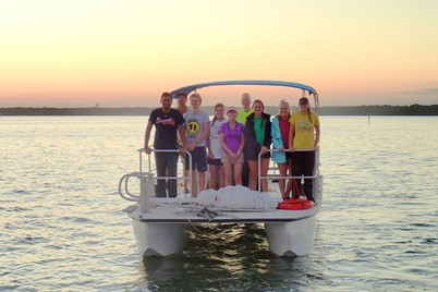 NGHS students on a pontoon boat at sunset