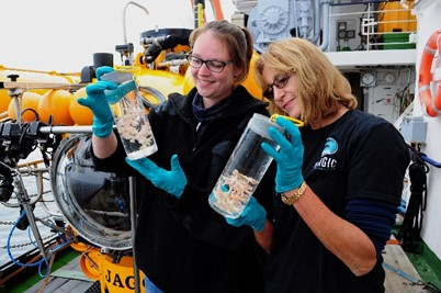 Janina Büscher (left) and Sandra Brooke (right) with coral samples collected using the submersible JAGO